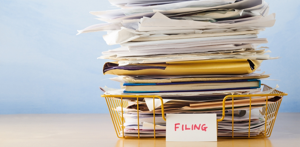 One of the office organization tips and tricks is to revise your filing system.